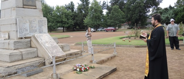 The Rector of the Russian Orthodox Church of St. Sergius of Radonezh delivers a requiem service at the grave of a Russian officer